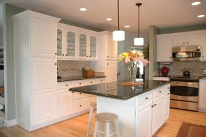 Kitchen design with dark granite countertop