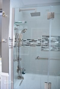Bath and shower combination with two showerheads