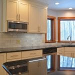Kitchen design with black countertop