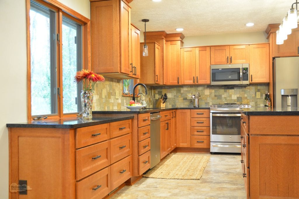 kitchen design with warm wood cabinetry