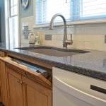 kitchen sink with cleaning supply storage