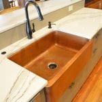 Kitchen design with copper farmhouse sink