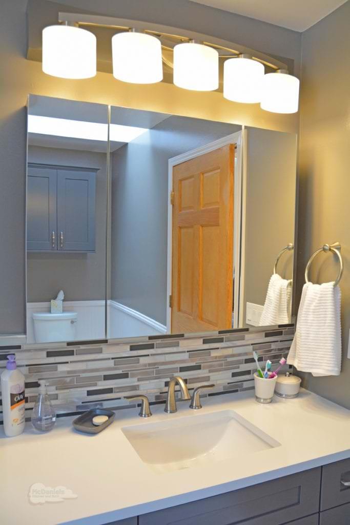 Bath design with lighting strip