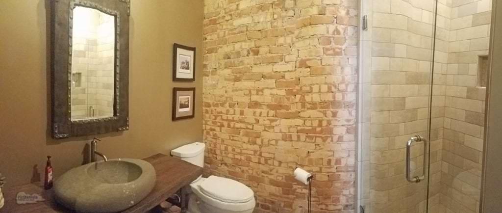 bath design with metal framed mirror
