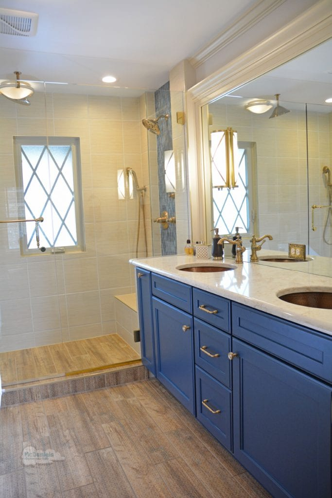 bathroom design with blue vanity cabinet