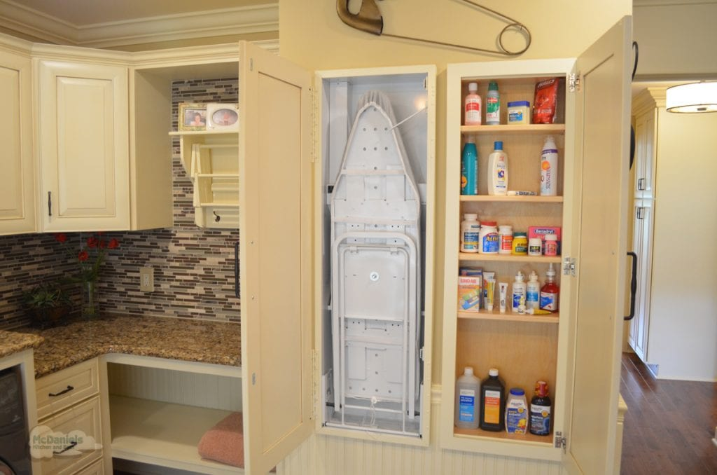 laundry room with pull down ironing board
