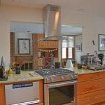kitchen design with stainless and glass hood