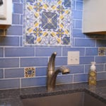 Blue and gold tile backsplash