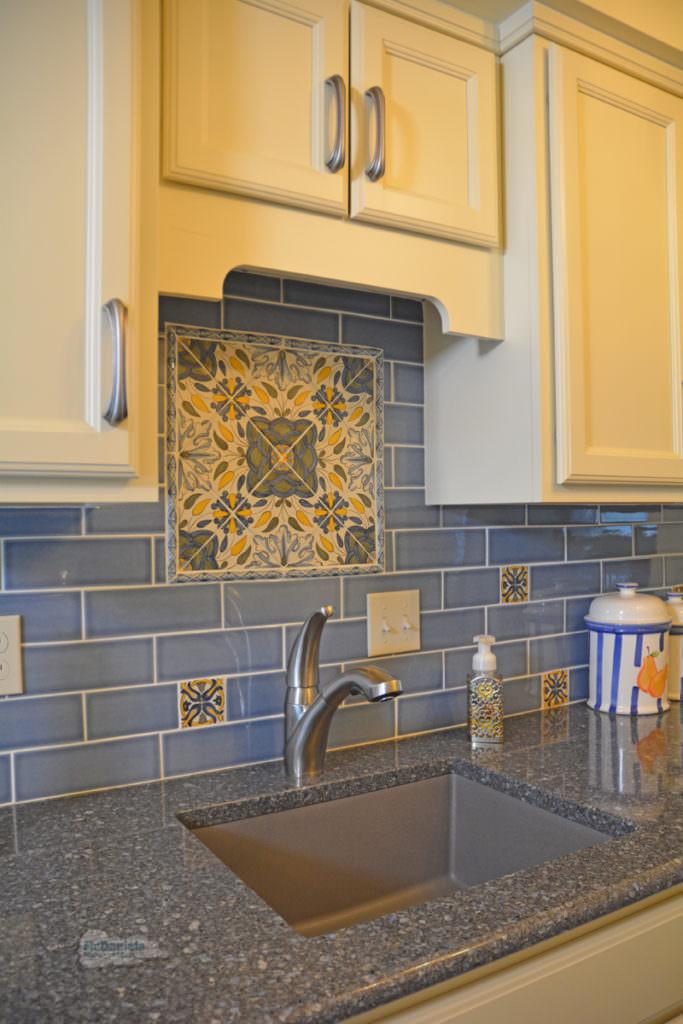 blue and gold tile backsplash