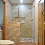 alcove shower with textured tiles