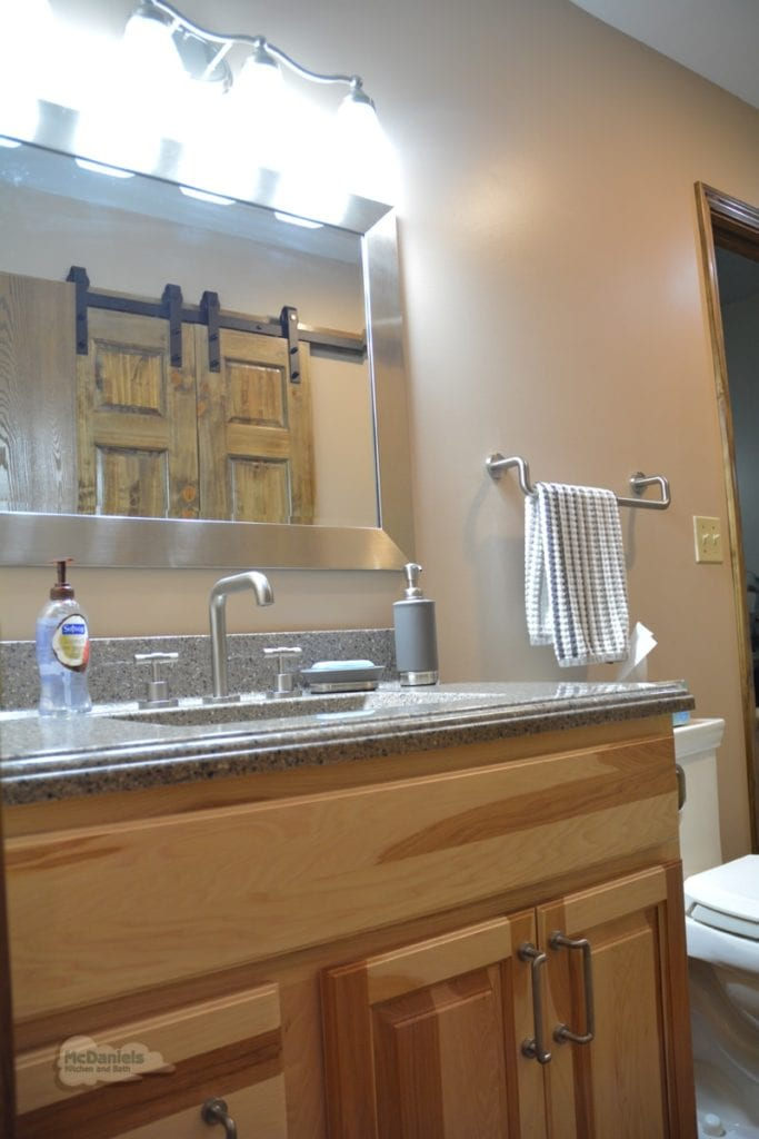bathroom design with wood vanity