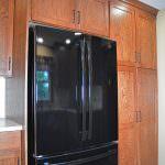 kitchen design with black refrigerator