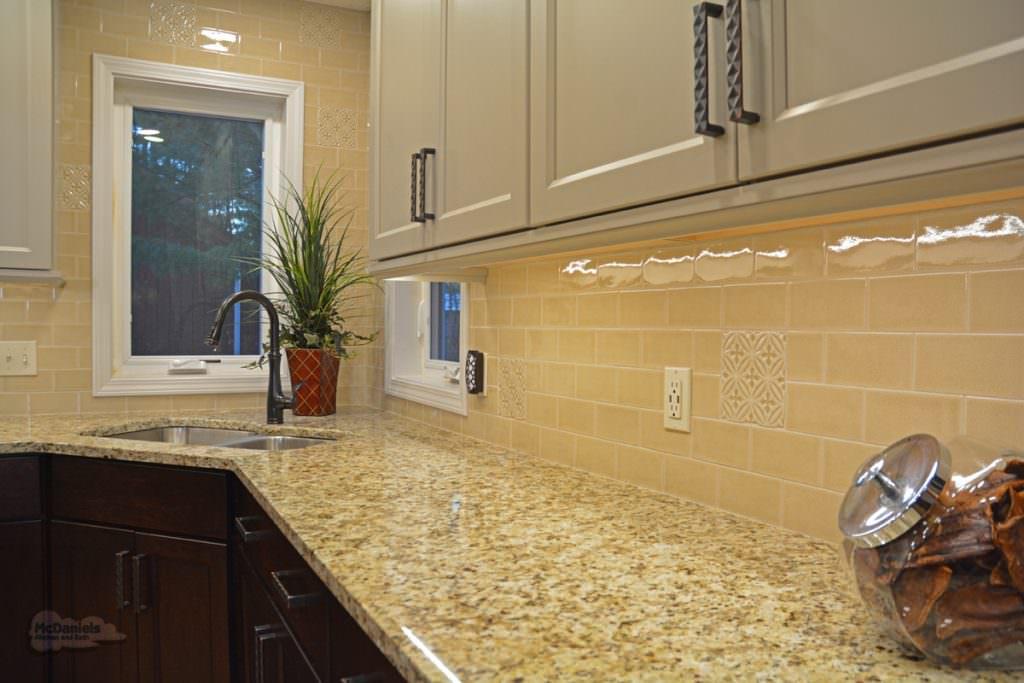 yellow tile backsplash