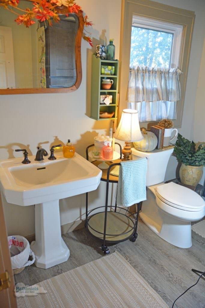bath design with freestanding furniture