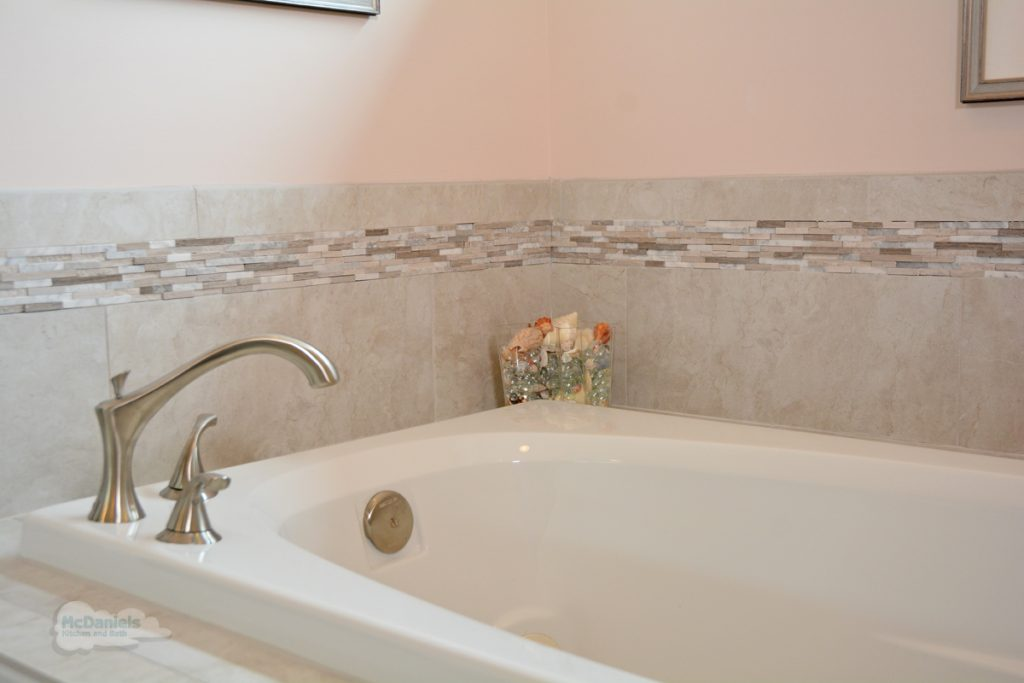 bathtub with corner faucet