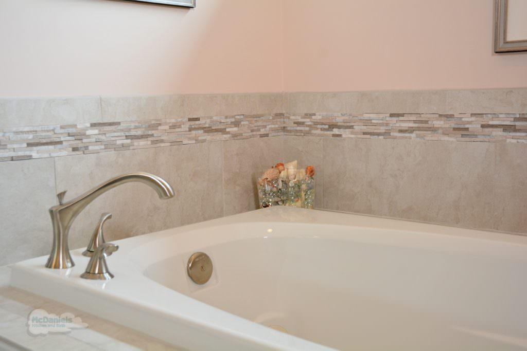 bathtub with corner faucet