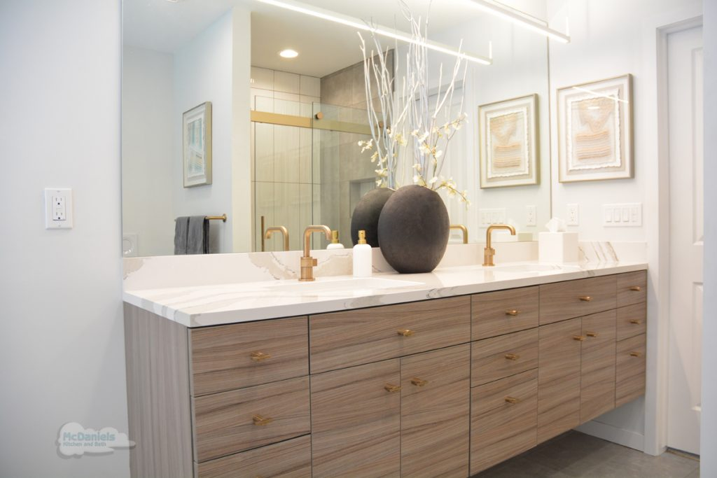 bathroom vanity with gold faucets