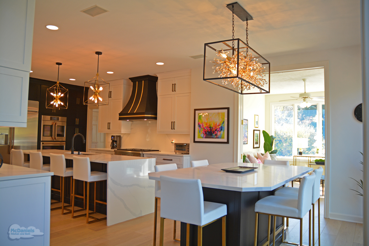 black and white kitchen design with gold accents