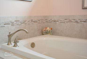 bathtub with corner deck mount faucet