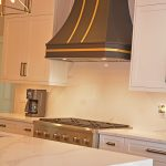 kitchen with black and gold hood