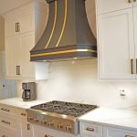 white kitchen cabinets with black hood