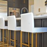 black island with white and gold barstools