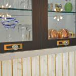 glass front cabinets and marble tile backsplash