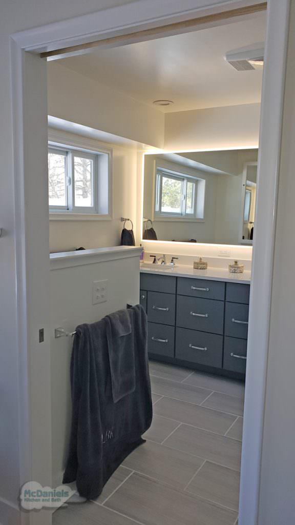 bathroom vanity and backlit mirror
