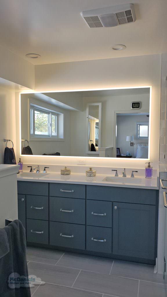 master bath vanity and backlit mirror