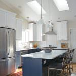 white kitchen design with blue island